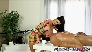 Busty masseuse stroking