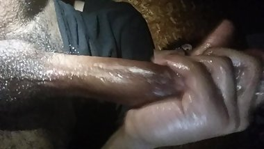 Mystery guy in black stroking his big black cock
