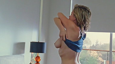 Sonya Walger take her top off, exposing her big breasts