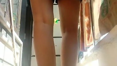 Risky Indian schoolgirl showing nude bare ass from balcony