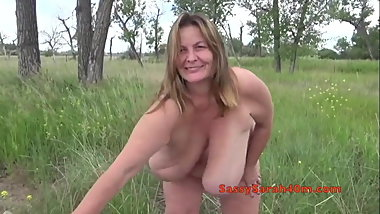 Big hanging tits in the meadow