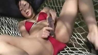 Stuffing her wet vagina with a sex toy so damn deep