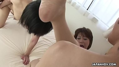 Insatiable Japanese women are having group sex in the bedroom