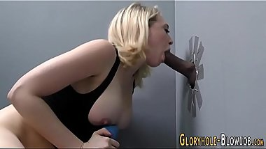 Busty slut tugs black rod