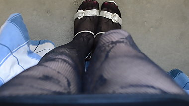 Mini Skirt Fishnet Pantyhose and High Heels