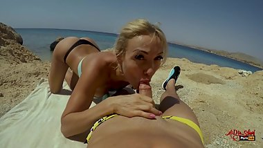 Public blowjob on the beach