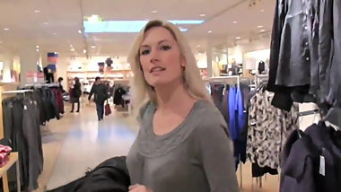 two delicious milf using strapon in public fitting room