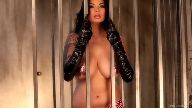 Tera Patrick caged in sexy erotic video stripping to be naked
