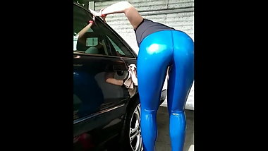 THE WIFE OF A NEIGHBOR WASHING THE CAR